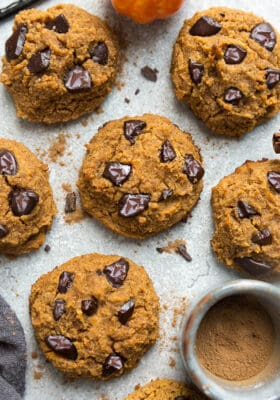 Close-up top view of 6 low carb keto pumpkin cookies on a grey background