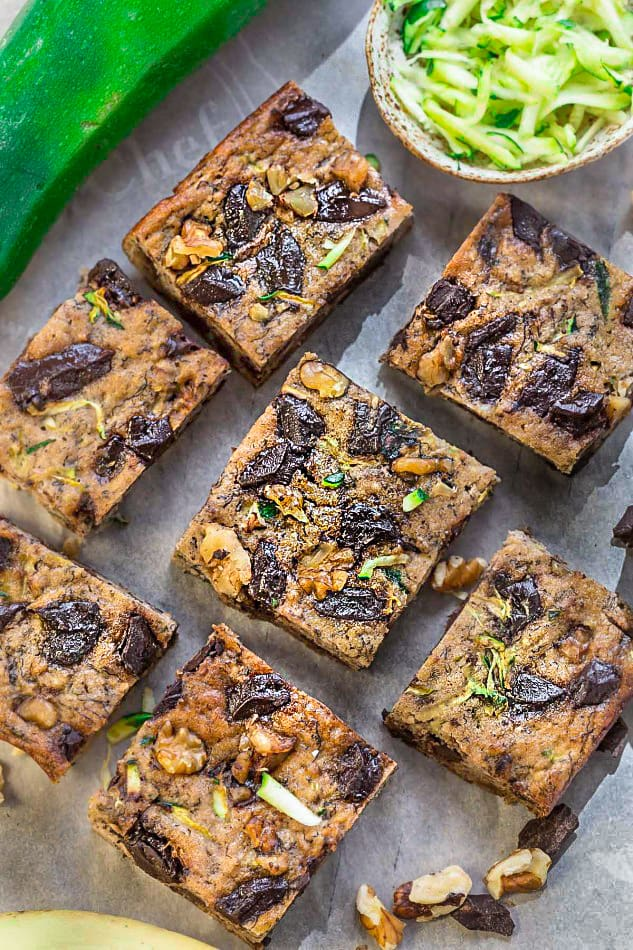 Paleo Pumpkin Zucchini Bars with Chocolate Chunks make the perfect healthy gluten free snack. Best of all, they're refined sugar free and will still satisfy that sweet tooth craving!