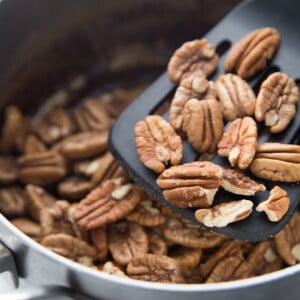 Top view of roasted pecans in a pot