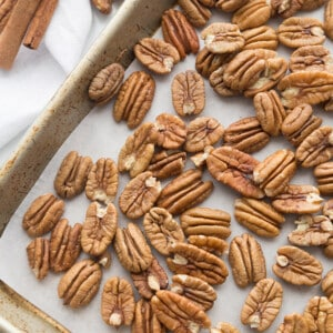 Top view of raw pecans on a baking sheet