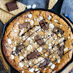 Top view of a s'mores cookie skillet in a cast iron pan
