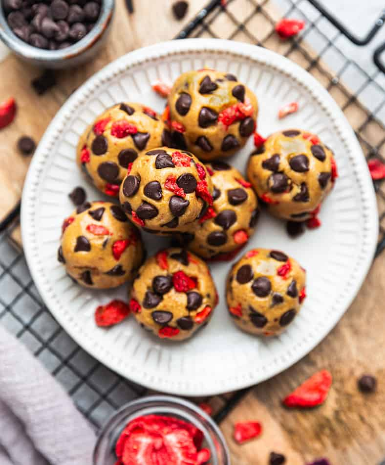 Overhead view of Strawberry Protein Balls with chocolate chips on a plate