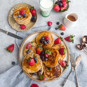 Low Carb Pancakes - soft and fluffy pancakes that are grain free and keto-friendly. Bursting with fresh berries, it's the perfect low carb breakfast!