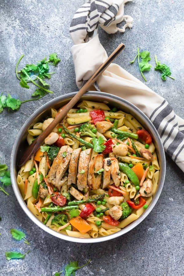 Top view of pasta primavera with chicken in a skillet