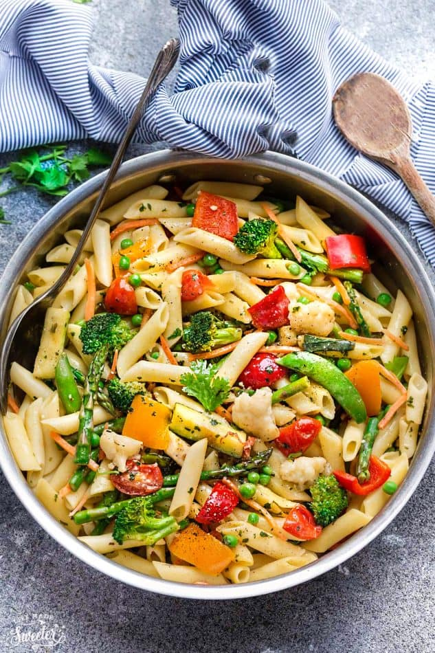 This Pasta Primavera recipe comes together in under 30 minutes so it's perfect for busy weeknights. Best of all, it's chock full of fresh lemon, asparagus, snap peas, carrots and cherry tomatoes.
