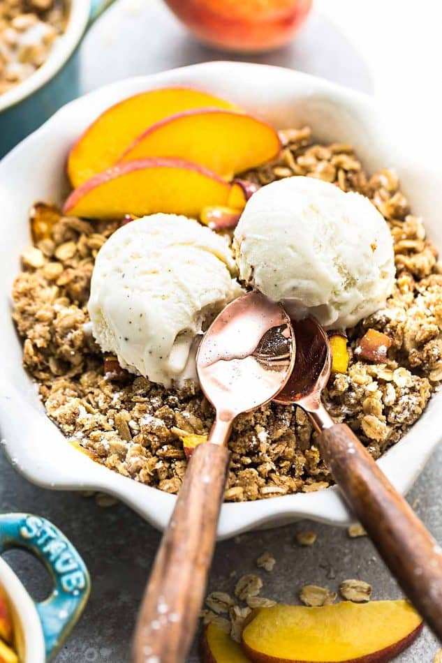 This recipe for Peach Crisp is the perfect easy treat for summer. Best of all, this delicious dessert is gluten free and contains no butter. Made with fresh juicy sweet peaches, and the crispiest oat crumble topping. Serve it bubbling hot with some creamy vanilla ice cream for the ultimate dessert!