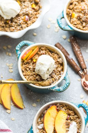 This recipe for Peach Crisp is the perfect easy treat to celebrate the end of summer. Best of all, this delicious dessert is gluten free, butter free and is less in added sugar. Made with fresh juicy sweet peaches, and the crispiest oat crumble topping. Serve it bubbling hot with some creamy vanilla frozen yogurt or vanilla ice cream for the ultimate dessert.
