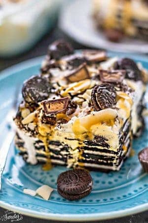 Peanut Butter Oreo Icebox Cake - the perfect easy and cool dessert for summer potlucks, barbecues, picnics, parties and cookouts. Best of all, only a few ingredients with layers of Oreo cookies, Reese's peanut butter cups and sweet rich caramel sauce. So delicious and always a crowd-pleaser!