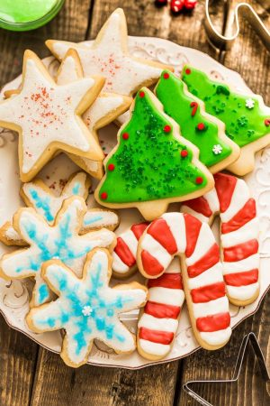 The BEST sugar cookie recipe for making decorated cut out Christmas / holiday shapes with perfect edges. Best of all, these delicious cookies bake up soft, flavorful and are easy to make with a just a few pantry ingredients. Plus instructions on how to decorate with royal icing and tips on how to make amazing cookies that don't spread. Perfect for Santa's cookie tray or holiday parties.
