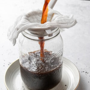 Cold brew getting strained in a mason jar