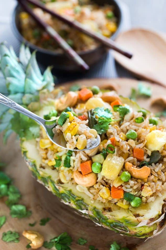 This Pineapple Fried Rice recipe is the perfect easy weeknight side dish to your meal. Best of all, it's easy to customize with any protein like chicken or shrimp. Plus it's also a great way to clean out your fridge with all those extra vegetables lingering around in the fridge. Leftovers also make a great meal to pack for work or school lunch bowls.