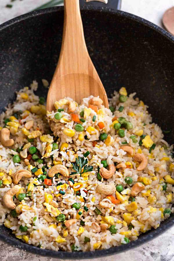making quick and easy pineapple fried rice in a wok