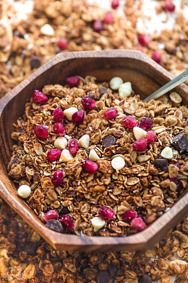 Pomegrante White Chocolate Granola makes the perfect holiday snack or breakfaast! Best of all, it's so easy to make and full of big crunchy clusters!