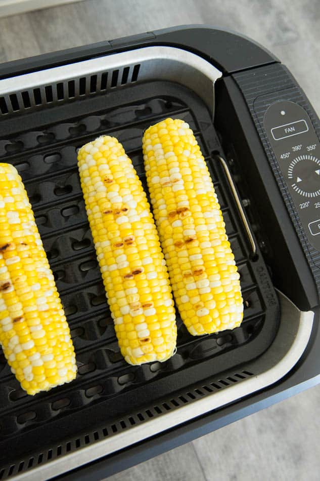 Close-up view of ears of corn in a Power Smokeless grill