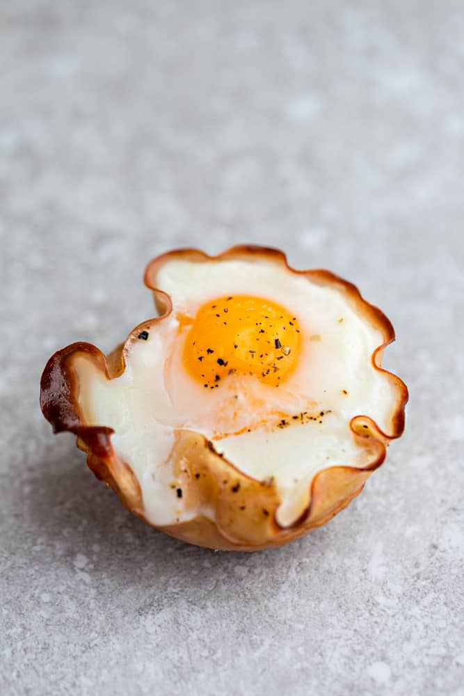 Proscuitto Baked Egg Cups - 9 Ways are the perfect low carb and protein packed breakfast. Best of all, they are super simple to customize and come together in less than 30 minutes!