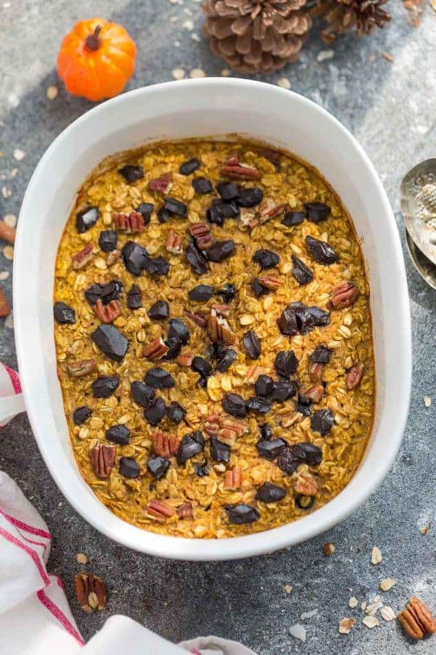 Pumpkin Baked Oatmeal with Chocolate and Pecans - the perfect easy make-ahead breakfast or brunch for fall! Best of all, you can bake them into muffin tins for grab and go oatmeal cups or take them along to work or school. They're full of cozy warm flavors and come together easily in just one bowl using healthy and wholesome ingredients. Gluten free & refined sugar free.