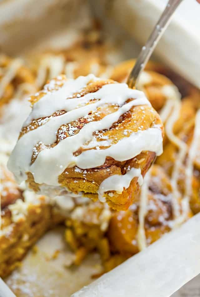 Pumpkin Cinnamon Rolls make the perfect indulgent breakfast or brunch. They're soft, fluffy and made completely from scratch. The best part is, how easy you will fall in love after one bite and even better how amazing your house will smell while these delicious rolls bake in your oven!