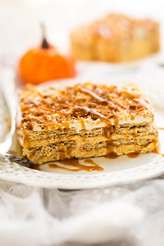 No Bake Pumpkin Icebox Cake makes the perfect make ahead fall dessert. Best of all, takes just minutes to whip up and full of cozy fall flavors! Made with layers of graham crackers and pumpkin cream cheese mousse. A delicous dessert for holiday parties and get togethers and much easier to bring than a pumpkin pie.