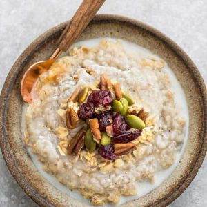 Pumpkin Steel Cut Oats - the perfect healthy make-ahead breakfast for fall. Made with gluten free oats, cozy fall spices, pumpkin puree, dried cranberries & pepitas. Best of all, includes instructions for the Instant Pot pressure cooker & the stove.
