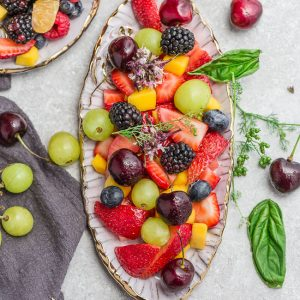 Top view of healthy fruit salad in an oval platter