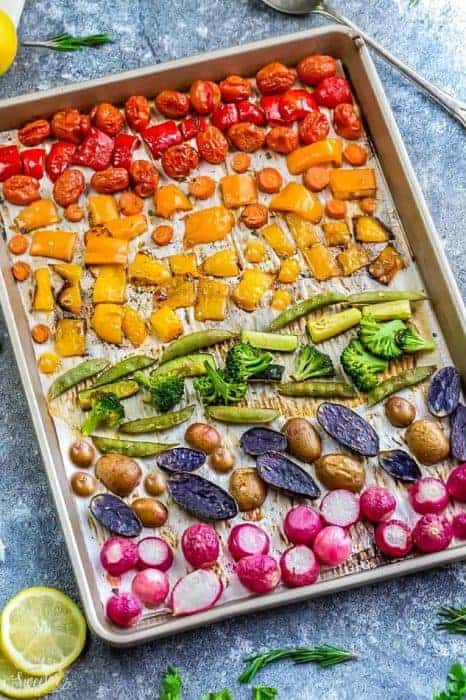 Top view of rainbow roasted vegetables on a sheet pan