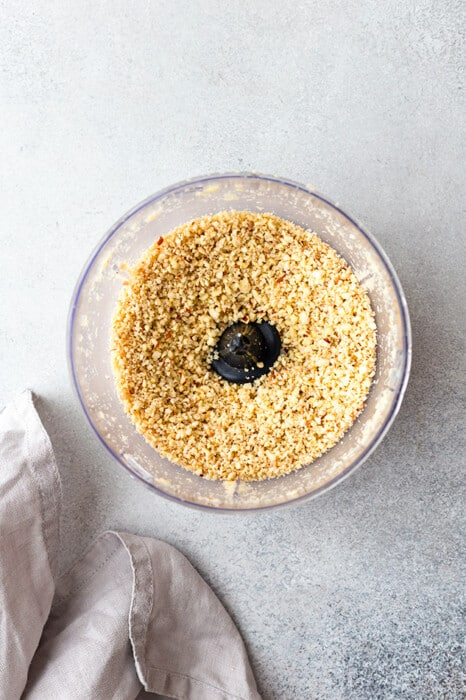 Top view of blended cashews in a food processor