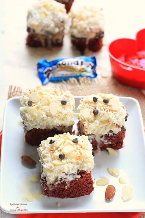 Red Velvet Almond Joy Gooey Cake Bars - Melted chocolate, a sweet thick gooey coconut layer and slivered almonds add an indulgent Almond  Joy Candy Bar twist to these delicious and easy classic red velvet cake bars. by @LifeMadeSweeter