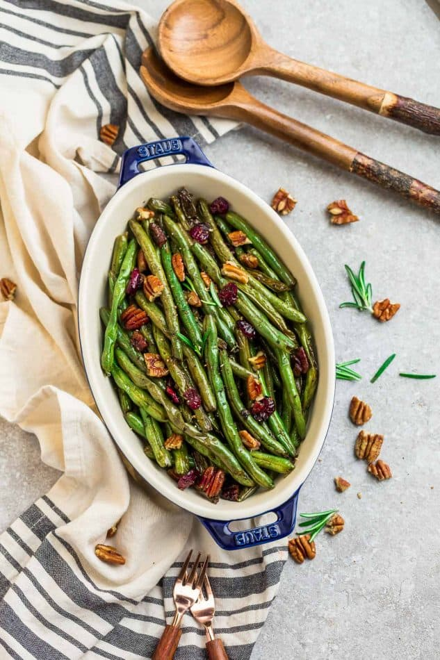 Roasted Green Beans with garlic, balsamic, lemon pepper pecans (and optional cranberries) is the perfect simple recipe to enjoy fresh green beans. This recipe is fancy enough for Thanksgiving, Christmas, or Easter holiday meal, and easy enough for a weeknight side dish! #sidedish #Thanksgiving #christmas #healthy #balsamic #garlic #roasted #vegetables #healthy #keto #paleo #lowcarb