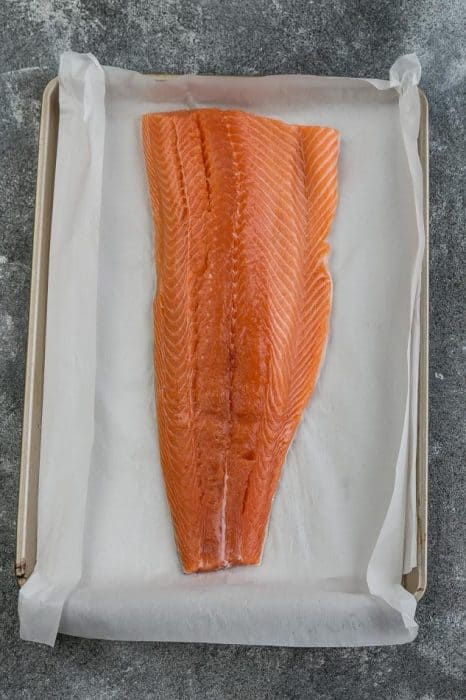 Raw Salmon on a Baking Sheet Lined with Parchment Paper