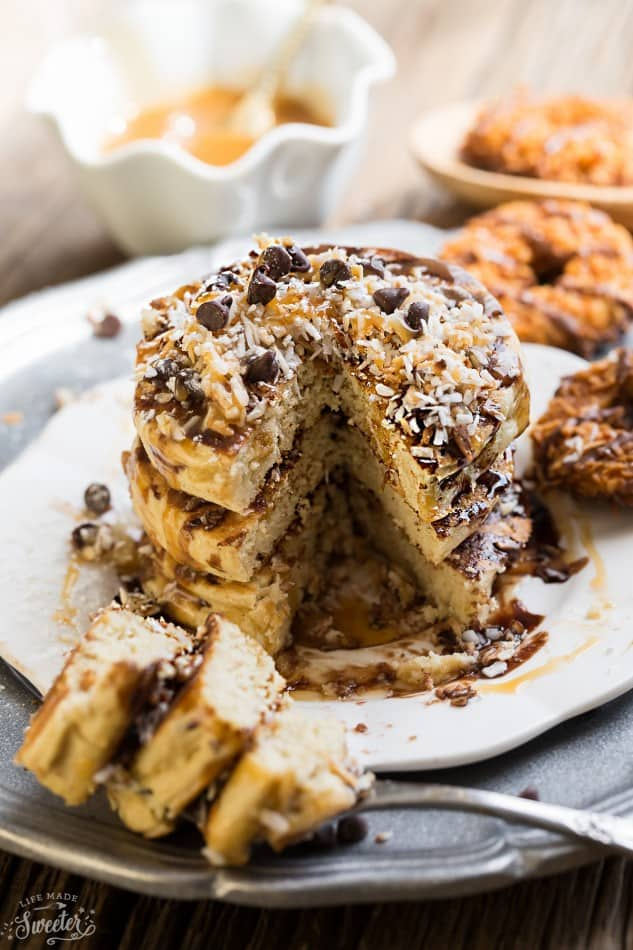 These Samoa Pancakes are the perfect way to enjoy the popular Girl Scout Cookie all year round. Best of all, these soft and fluffy pancakes are so easy to make with layers of toasted coconut, melted chocolate and gooey caramel.