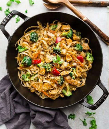 Asian Sesame Chicken Noodles - a one pot 30 minute meal perfect to curb those takeout cravings. Made with chicken, veggies, gluten free rice noodles and a delicious savory Asian-inspired sauce.