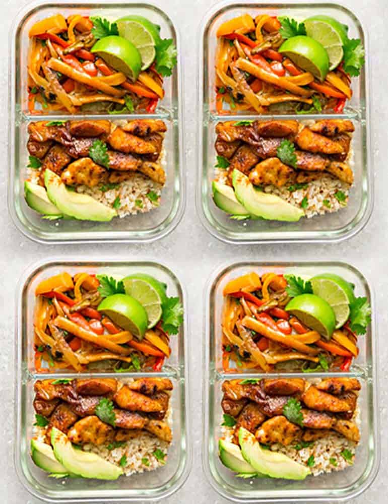 4 meal prep containers filled with Sheet Pan Chicken Fajitas