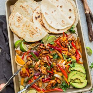 Sheet Pan Chicken Fajitas - a quick, simple and tasty one pan meal with minimal clean-up is perfect for busy weeknights. Best of all, this easy 30 minute dish can be served over a bed of lettuce, cauliflower rice or with low carb tortillas for a keto-friendly version.