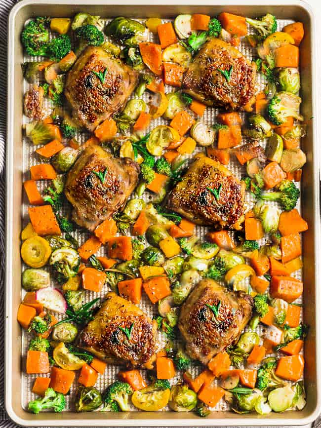 Sheet Pan Harvest Chicken with Vegetables - an easy complete one pan meal with low carb autumn vegetables perfect for fall. Made with tender and juicy with Brussels sprouts, pumpkin, broccoli and yellow zucchini. Keto, paleo, gluten free and Whole 30 compliant.