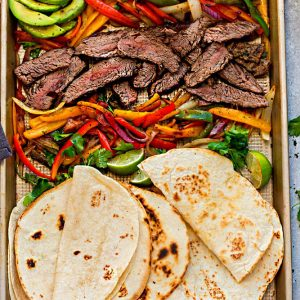 Sheet Pan Steak Fajitas are tender, juicy and full of flavor and perfect for busy weeknights! Best of all, options for low carb and keto with a homemade fajita spice blend and cilantro lime marinade.