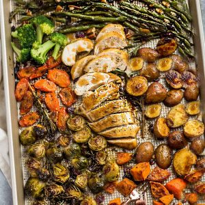 Sheet Pan Turkey Dinner For Two - an easy and healthy one panThanksgiving meal for two (or four). Best of all, everything cooks up in under an hour. Includes a juicy turkey, potatoes, green beans, carrots, sweet potatoes and cranberries.