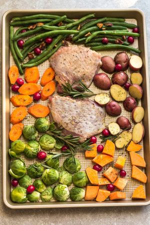 Sheet Pan Turkey Dinner For Two - an easy and healthy one pan Thanksgiving meal for two (or four). Best of all, everything cooks up in under an hour. Includes a juicy turkey, potatoes, green beans, carrots, sweet potatoes and cranberries.