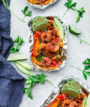 Shrimp Fajita Foil Packets - the perfect easy & healthy meal for summer grilling, camping and cookouts. Best of all, they're loaded with all your favorite Tex Mex flavors and make a low carb, paleo and keto friendly meal.