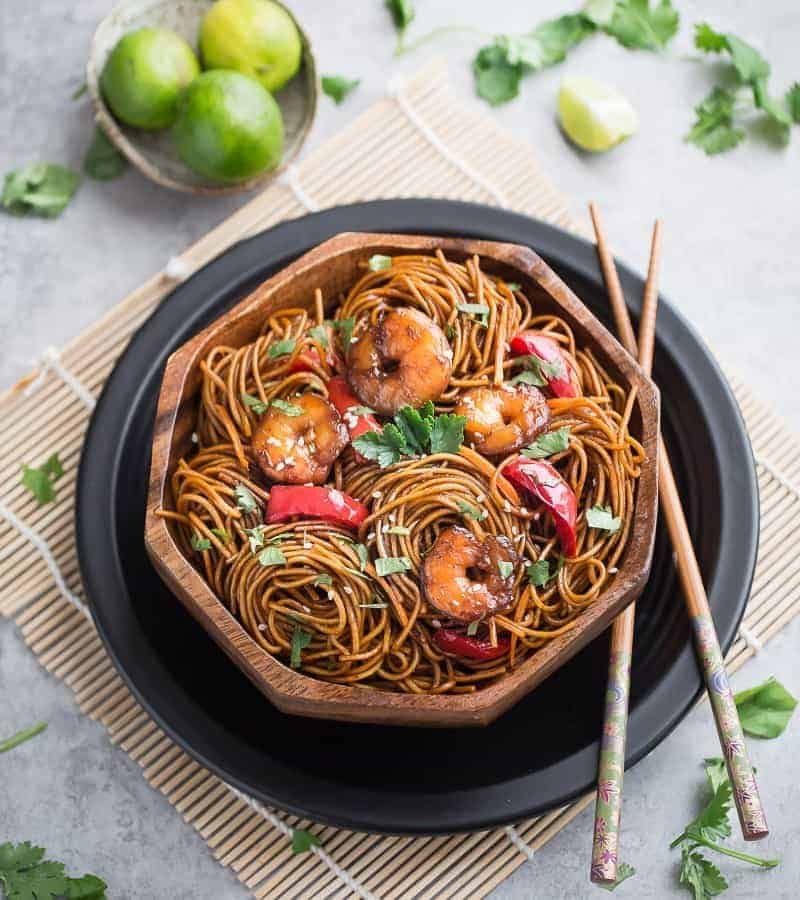 Top view of Shrimp Lo Mein in a bowl with chopsticks