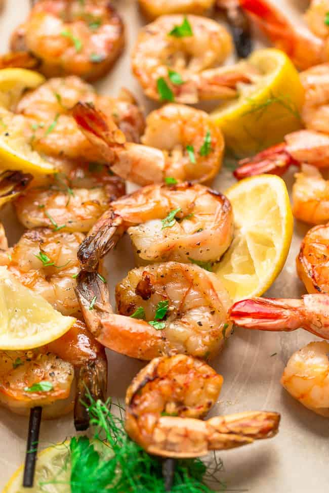 Grilled Shrimp Skewers with Lemon Herb Butter Sauce - seasoned with a fresh and flavorful citrus herb combo for the perfect light and tasty low carb dish for summer parties, lunches and dinners. Best of all, just a few ingredients and only 20 minutes to make.