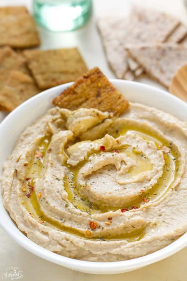This Simple Easy Hummus Without Tahini is super simple to make and just perfect for a quick snack. Best of all, takes less than 10 minutes to prepare. So much cheaper and better than the packaged stuff.