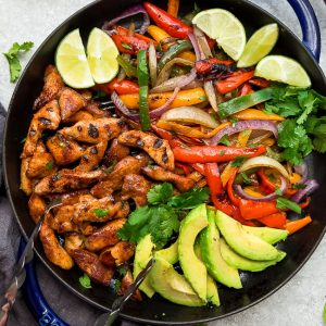Easy Chicken Fajitas - the perfect easy and healthy one pan meal for busy weeknights. Best of all, ready in 30 minutes with instructions for the grill or on a skillet. Bursting with chili lime flavors & served with low carb / keto friendly tortillas