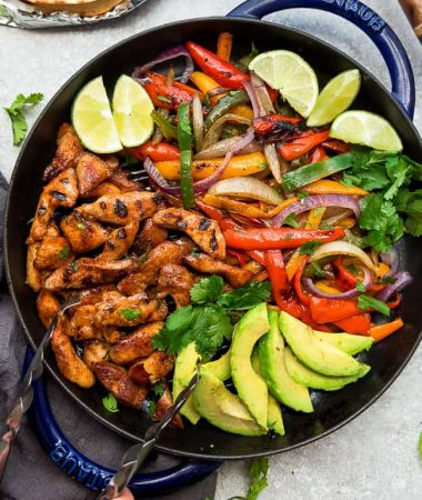 Easy Low Carb Chicken Fajitas - the perfect easy and healthy one pan meal for busy weeknights. Best of all, ready in 30 minutes with instructions for the grill or on a skillet. Bursting with chili lime flavors & served with low carb / keto friendly tortillas