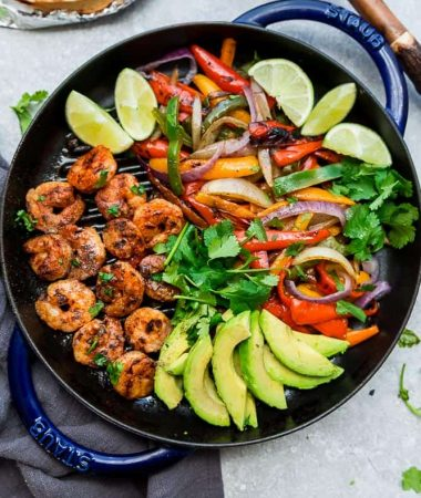 Skillet Shrimp Fajitas - the perfect easy and healthy one pan meal for busy weeknights. Best of all, bursting with chili lime flavors & served with low carb tortillas. Ready in just 20 minutes and easy to customize with chicken or steak.