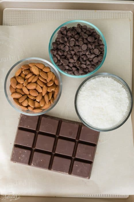 Slow Cooker Almond Joy Candy - an easy homemade candy bar with just 4 ingredients. Best of all, this recipe is made entirely in the crock-pot and tastes just like your favorite Almond Joy Candy Chocolate Bars. Just dump and go - SO EASY!!