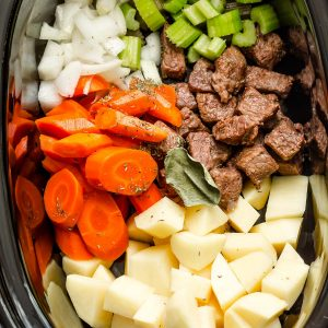 Top view of uncooked crockpot beef stew in a crockpot