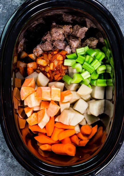 Top view of uncooked slow cooker beef stew in a crockpot