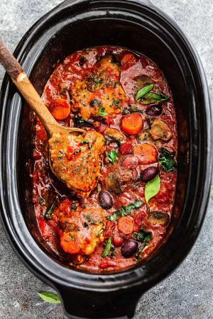 Crock Pot Chicken Cacciatore – an easy slow cooker meal loaded with tender chicken, tomatoes, bell peppers, kale, carrots and sliced mushrooms. Hearty, comforting and bursting with flavor. Best of all, this delicious Italian inspired recipe is so easy to customize with your favorite vegetables. With just 10 minutes of prep time making this perfect for busy weeknights or Sunday meal prep!