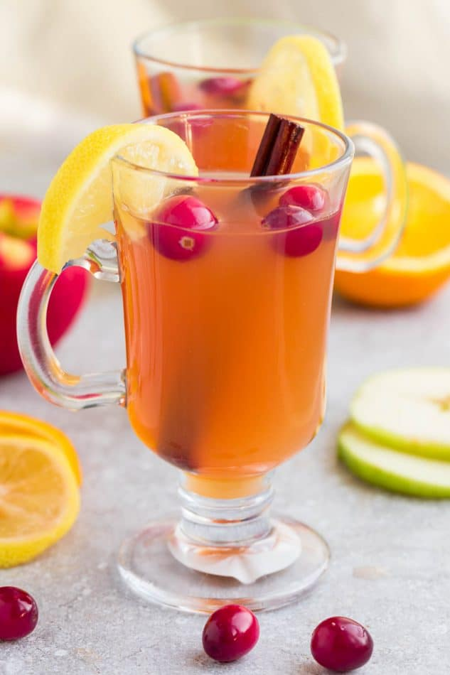 This Crock Pot Apple Cider Recipe is the perfect easy drink for fall and the holiday season. Best of all, made entirely in the slow cooker with apples, orange, lemon, cranberries, cinnamon and cloves. Set and forget and makes your house smell amazing! Warm up with a mug by a cozy fireplace.