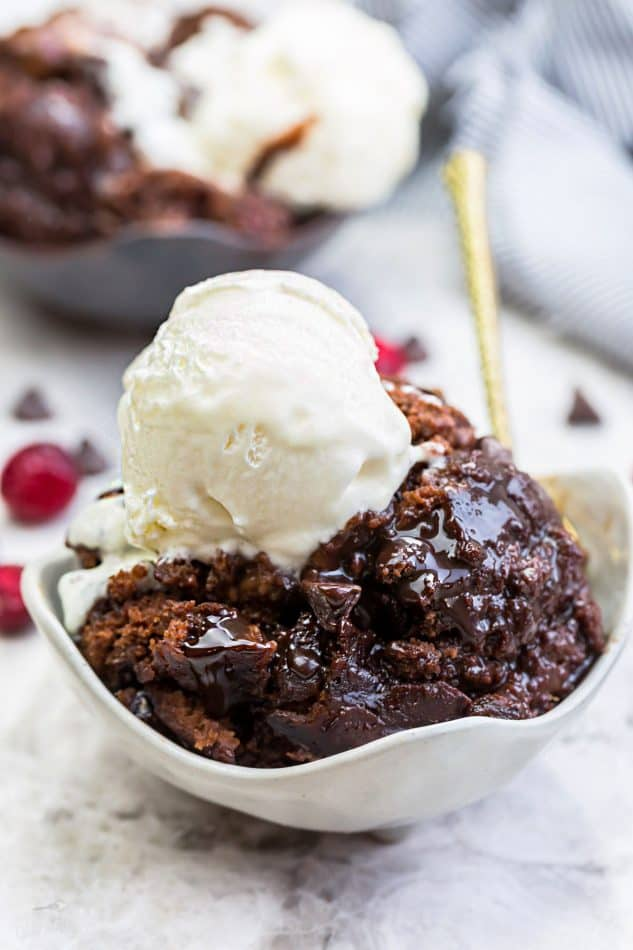 Slow Cooker Hot Fudge Pudding Cake an easy crock-pot dessert perfect for freeing up your oven. With a delicious sauce that forms beneath the cake and best part of all is how easy it is to customize with 4 fun toppings like an ice cream sundae! Plus a step-by-step video!